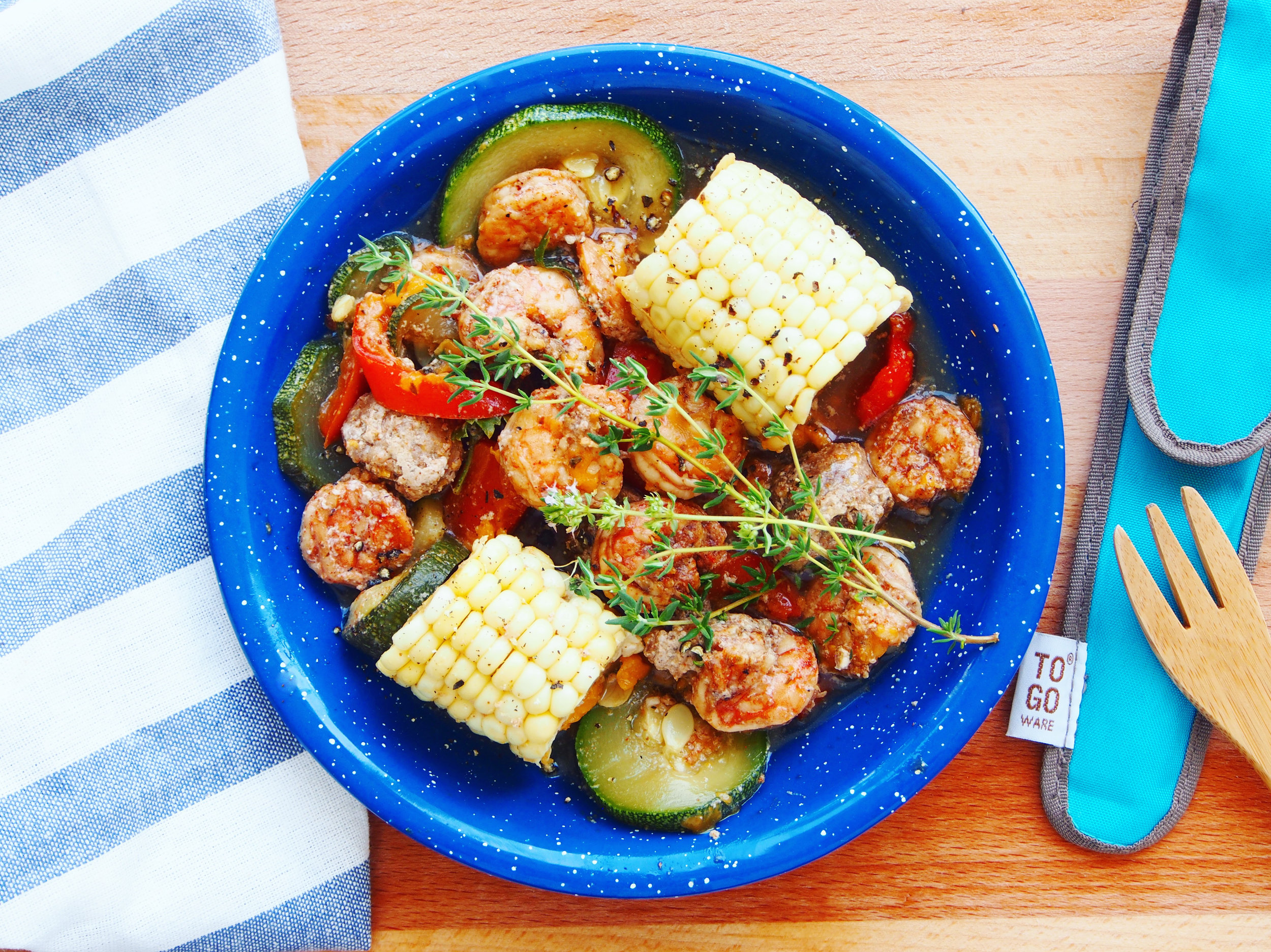 A foil packet meal with cajun shrimp, sausage, corn, and summer vegetables is a quick and easy recipe to celebrate summer! It's the best recipe for grilled shrimp with white wine and just enough of a spicy shrimp recipe to keep your tastebuds active!