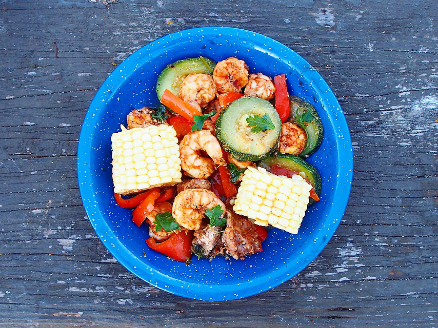 This Spicy Shrimp with Grilled Vegetables Foil Packet recipe is so delicious! It's a quick and easy grilling recipe for summer.