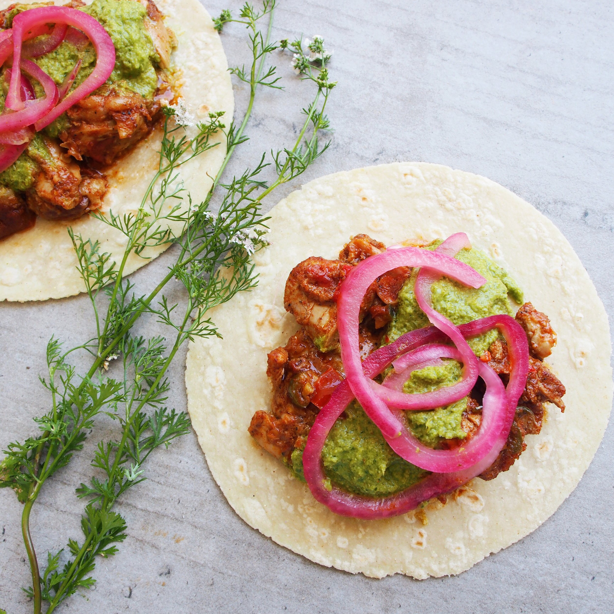 A recipe for chicken tikka masala tacos using Life is a Recipe's Chicken Tikka Masala Kit! The taco recipe is served with green chutney and pickled red onions.