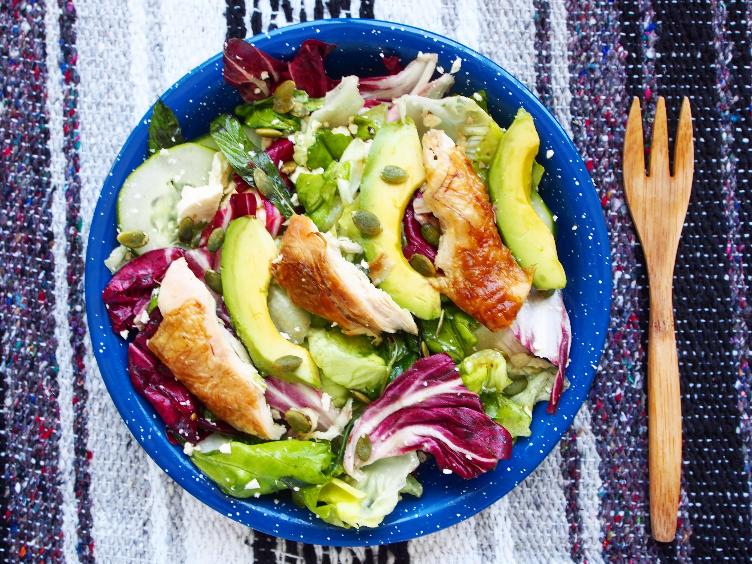 This chicken salad recipe is a main course salad recipe that can be served warm over a bed of greens. It's a delicious and quick salad recipe that's perfect for a weeknight dinner.