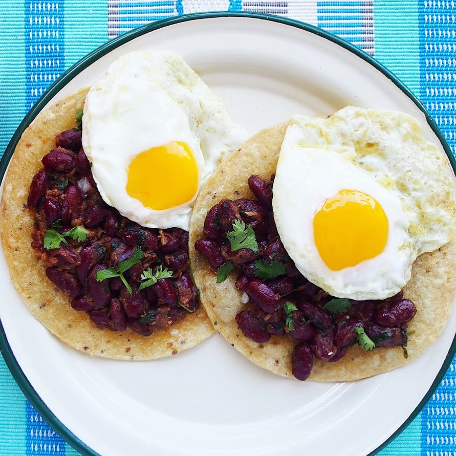 This chipotle-spiced bean taco recipe makes for quick and easy Mexican food! Plus it's a healthy Mexican recipe as well. The kidney beans make for a great filling and topping with a fried egg means that this is one of the best taco recipes you'll make for lunch or dinner!