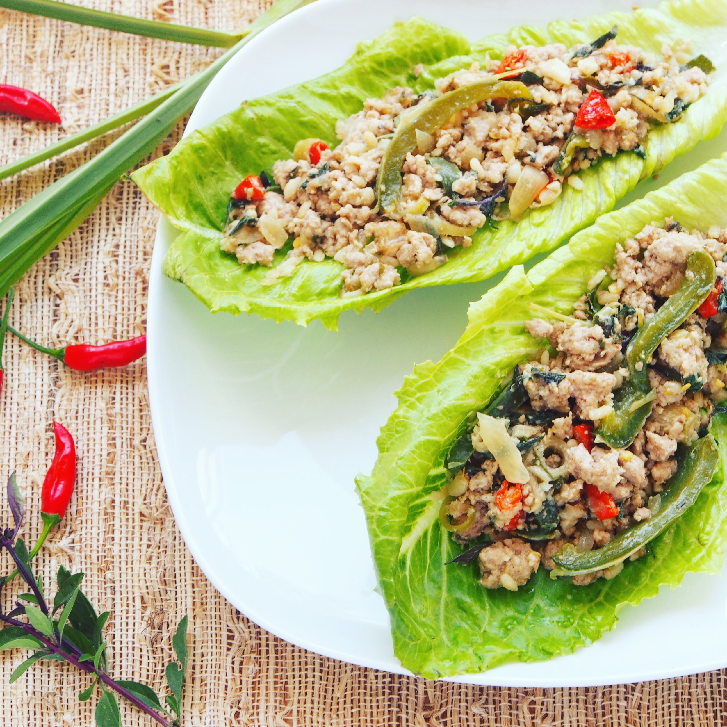 This Asian Lettuce Cup recipe is delicious! It's a quick stir-fry recipe that has a lot of Indonesian ingredients, including galangal, lemongrass, tamarind, and birdseye chilies. One of my favorite Indonesian recipes, you can make it as spicy as you like! It's also a quick recipe ready in 20 minutes or less!
