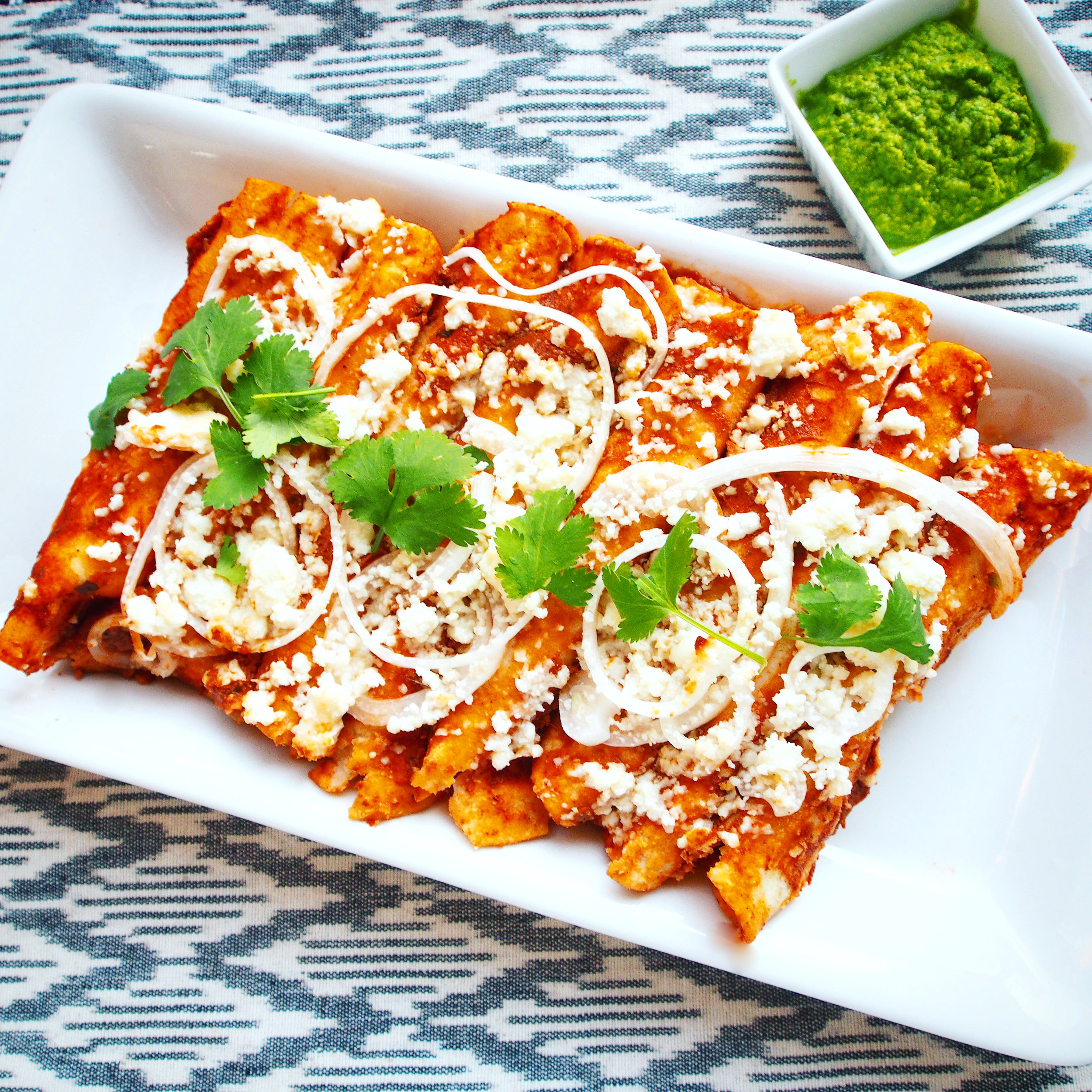 A quick and easy recipe for Chicken Tikka Masala Enchiladas with Cilantro Chutney made with Maya Kaimal's authentic Indian simmer sauces. This tasty enchilada recipe is a fusion between Mexican and Indian cuisines.