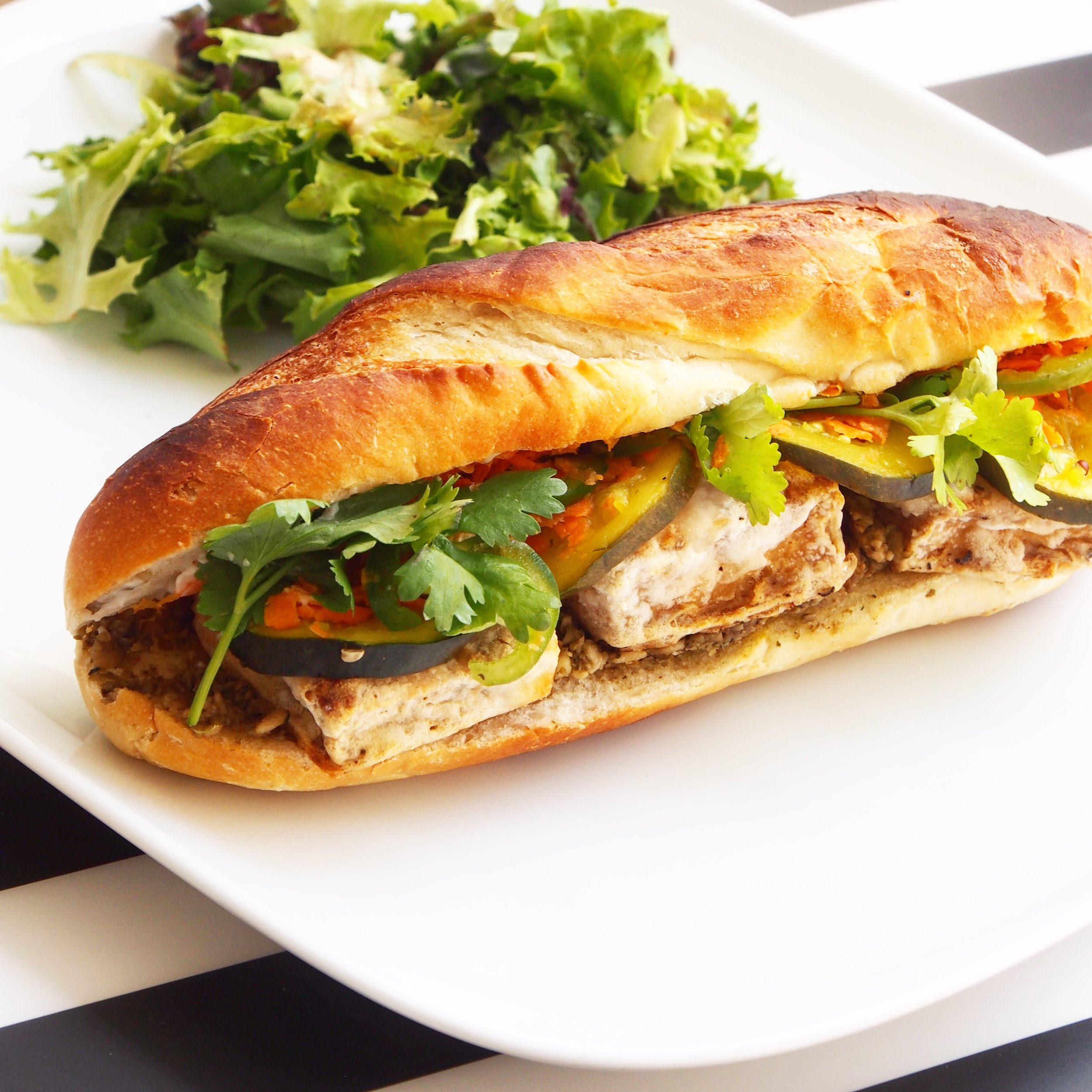 This is a wonderful vegan banh mi sandwich by Purple Carrot. It has crispy tofu and a sunflower seed paste that is out of this world delicious.