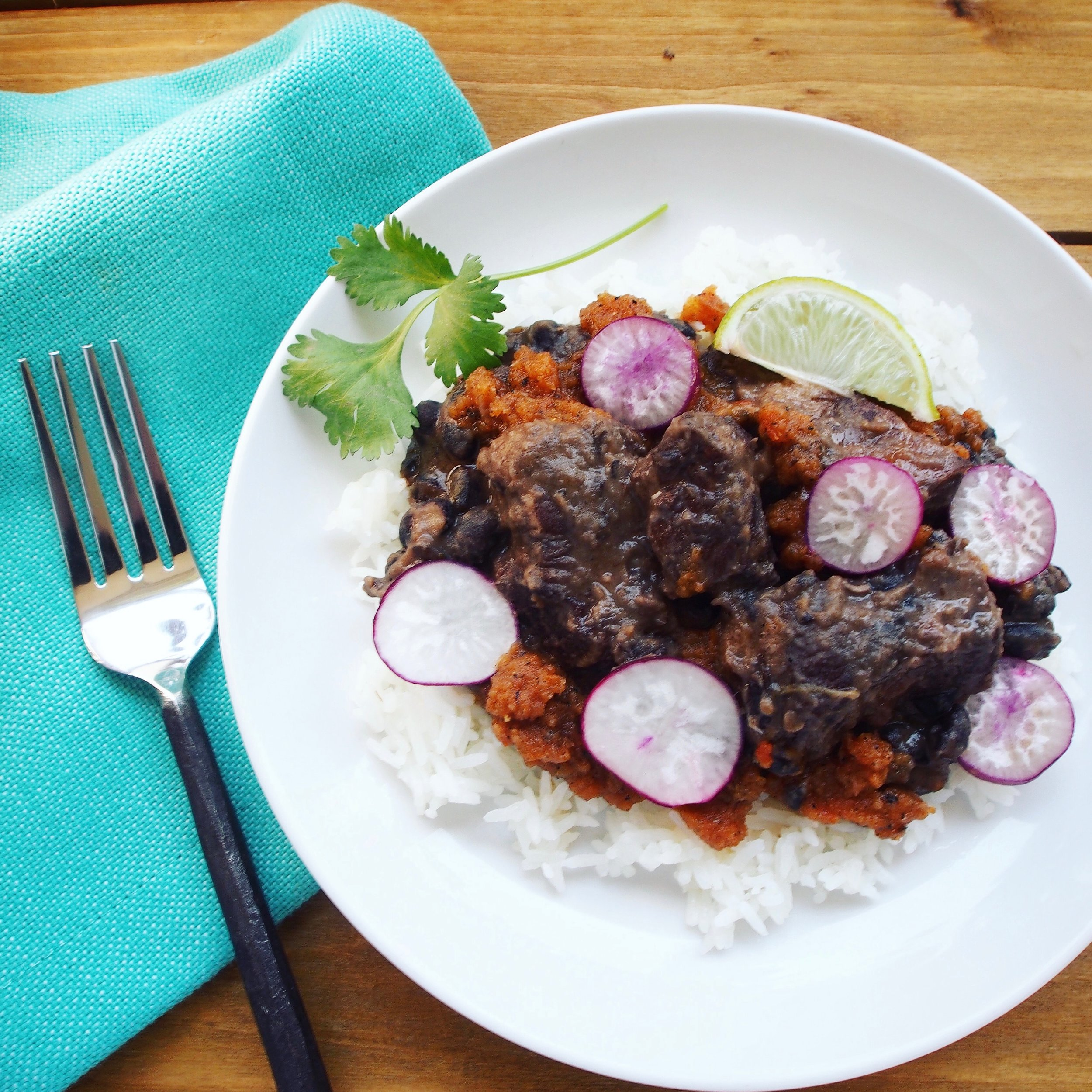Fijol con Puerco is a Pork Black and Bean Stew. This Mexican Stew is spicy with habanero powder and jalapenos. It uses spiceology's sweet and spicy habanero rub. The slow-cooked pork and beans are done in about 90 minutes.
