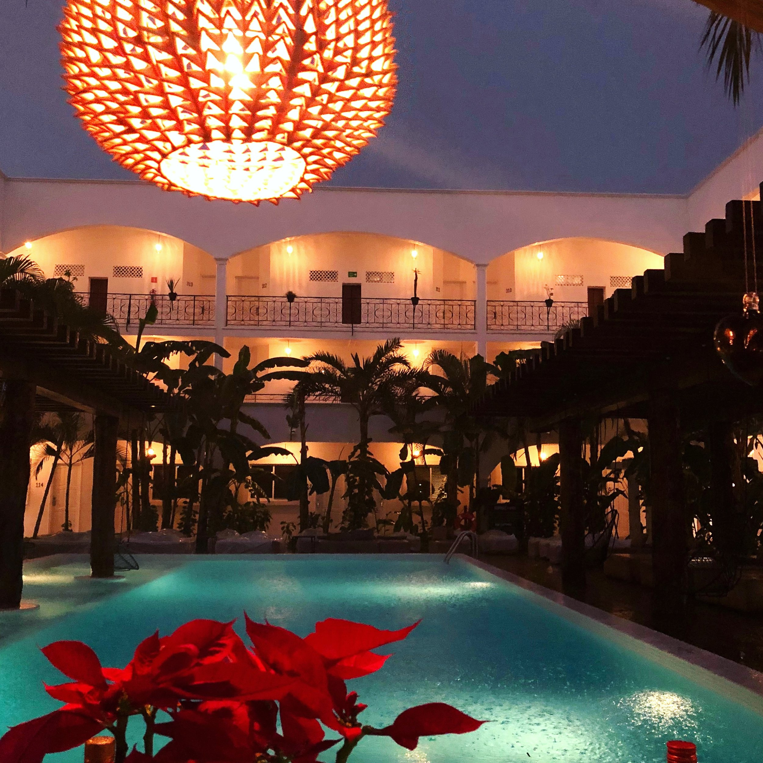This is an image of  our hotel pool at HM Playa Del Carmen in Playa del Carmen, Mexico. The pool is a great place to grab a beer, relax, and have nice conversations with staff.