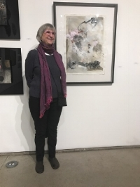 The artist next to her work at a recent exhibit.