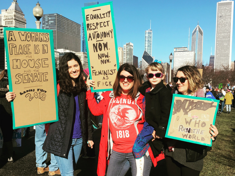 The author, center, marching with family & her 5 year-old daughter in Chicago