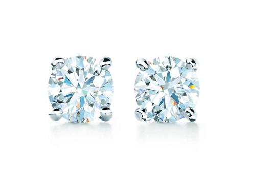 - TIFFANY SOLITAIRE DIAMOND EARRINGS, $1,200