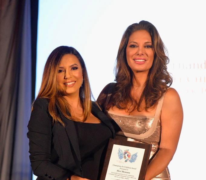 Eva Longoria presenting a Champions for Children's Award to longtime friend Alex Meneses; Photo by Michel Tullburg/Getty Images