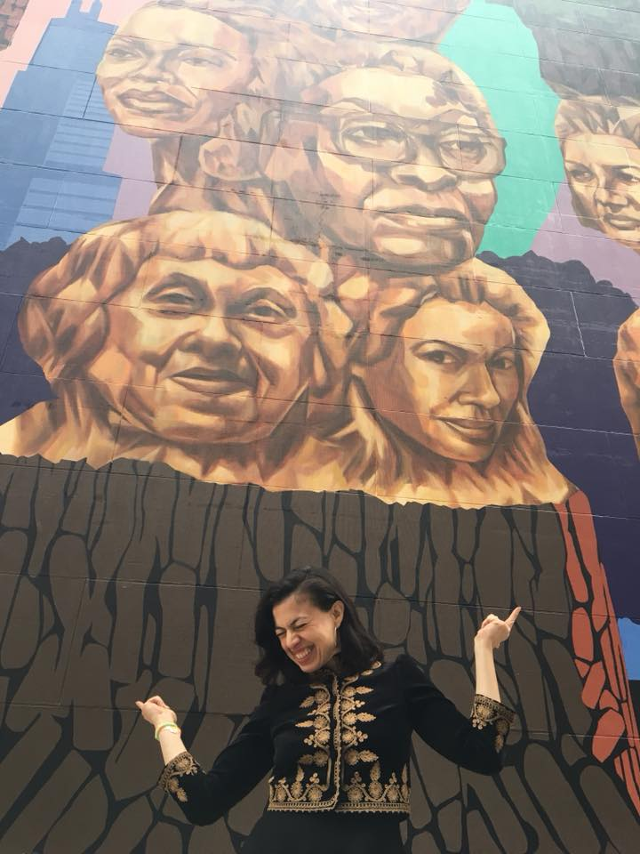 Sandra Delgado at the unveiling of her mural at the Chicago Cultural Center