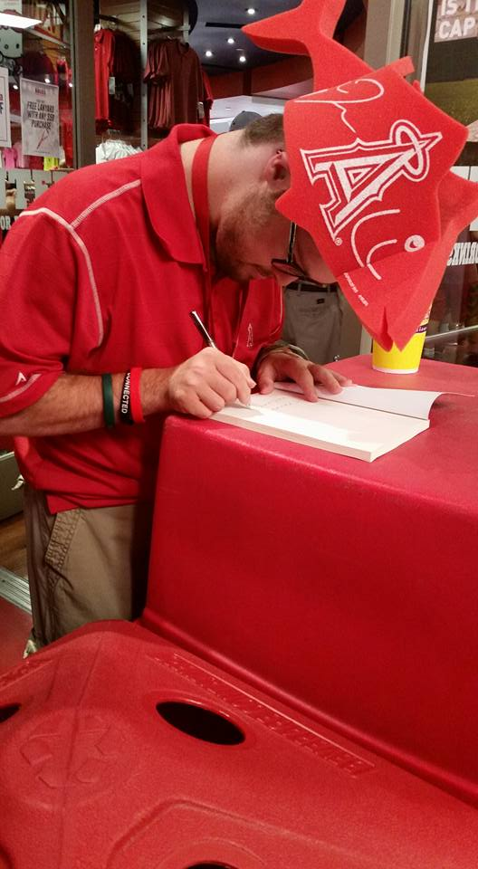 Trevor signing  Angel for Higher  at Angel Stadium.