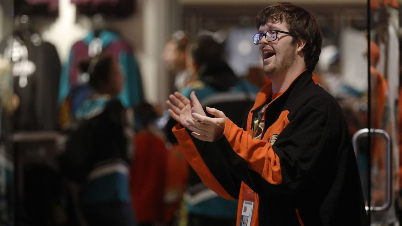 Trevor cheering on his Anaheim Ducks while hard at work as their Team Store Greeter.