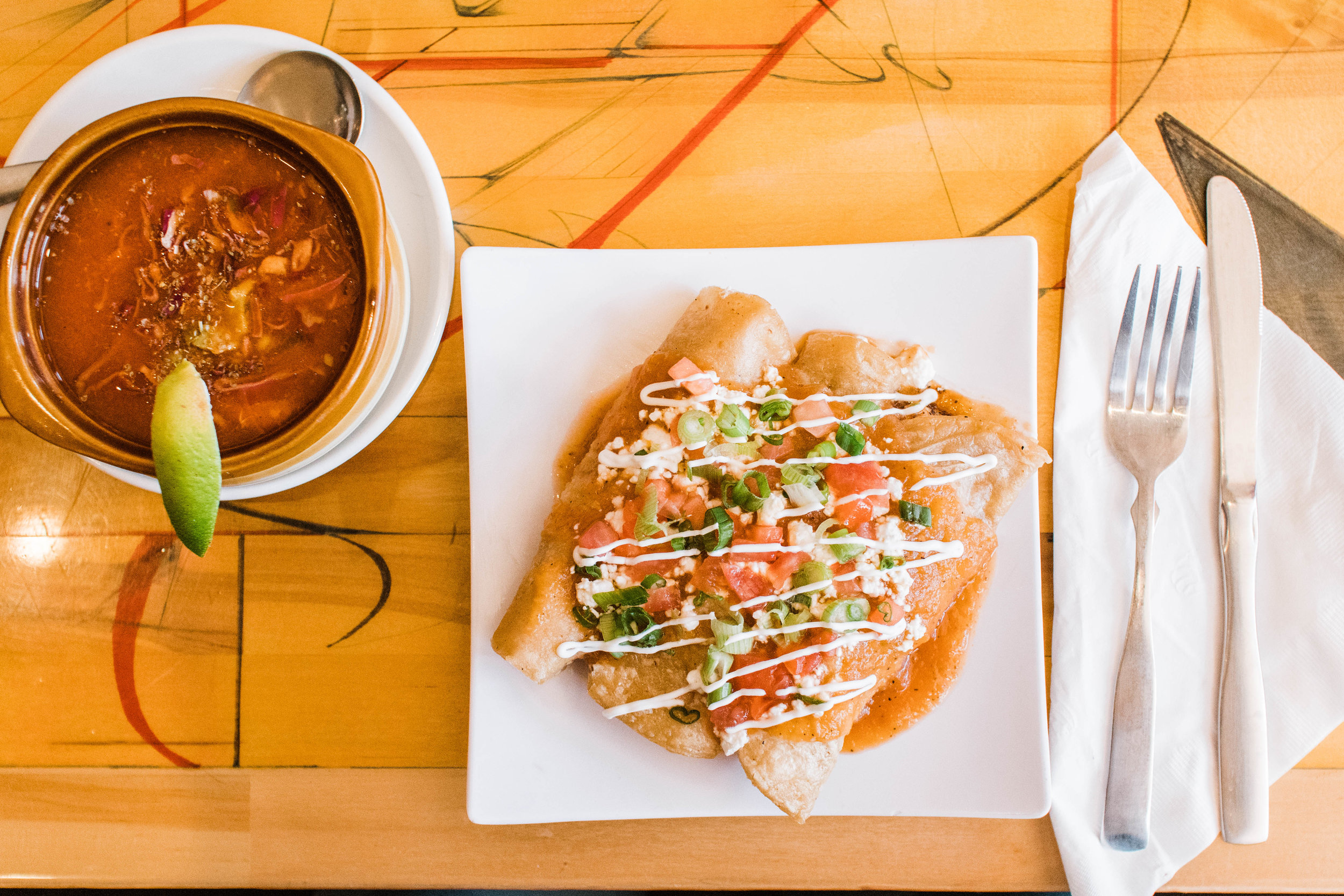 Chicken enchiladas and chicken pozole at Estrella Negra