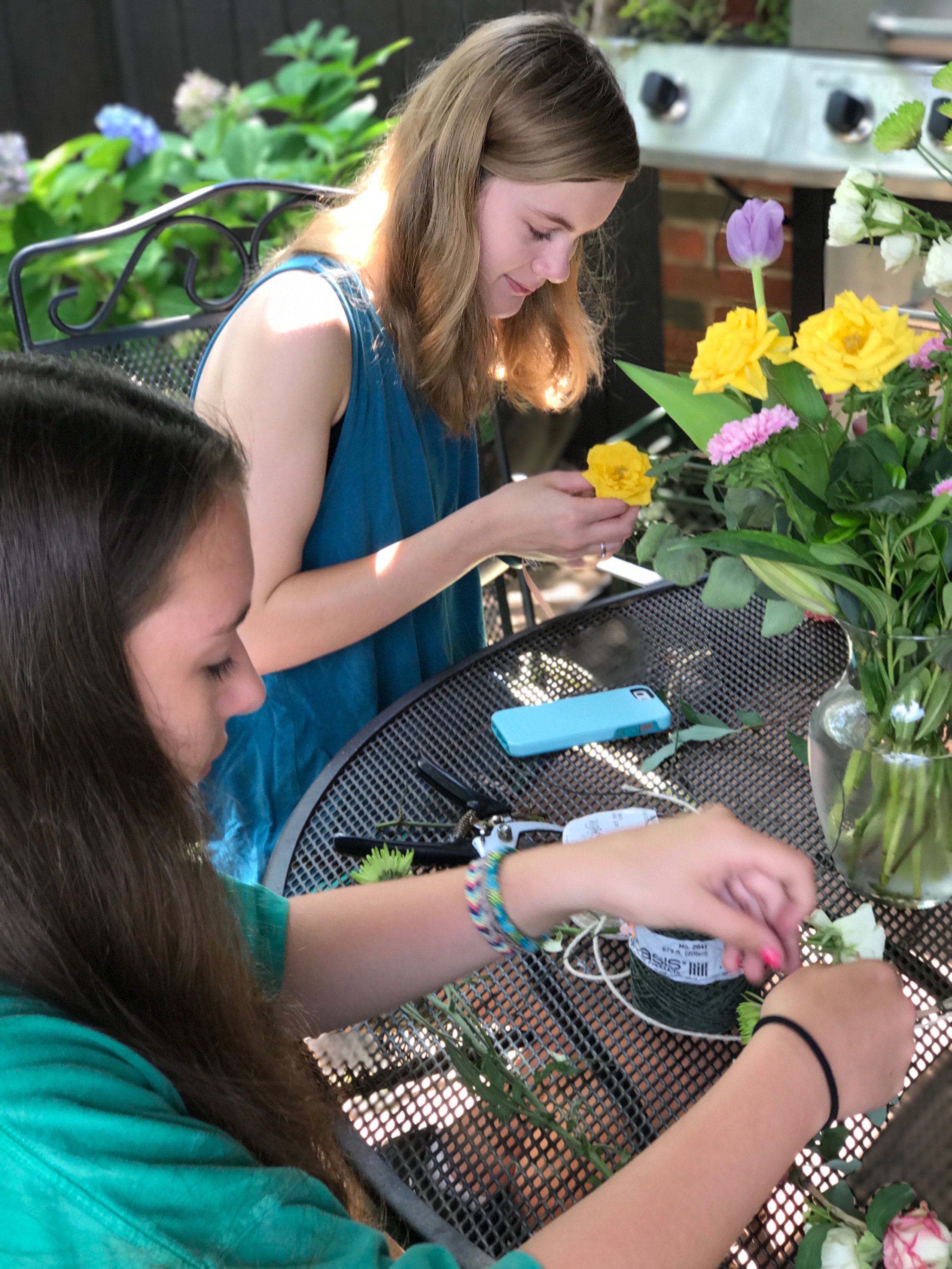 These girls are working hard on some flower crowns!
