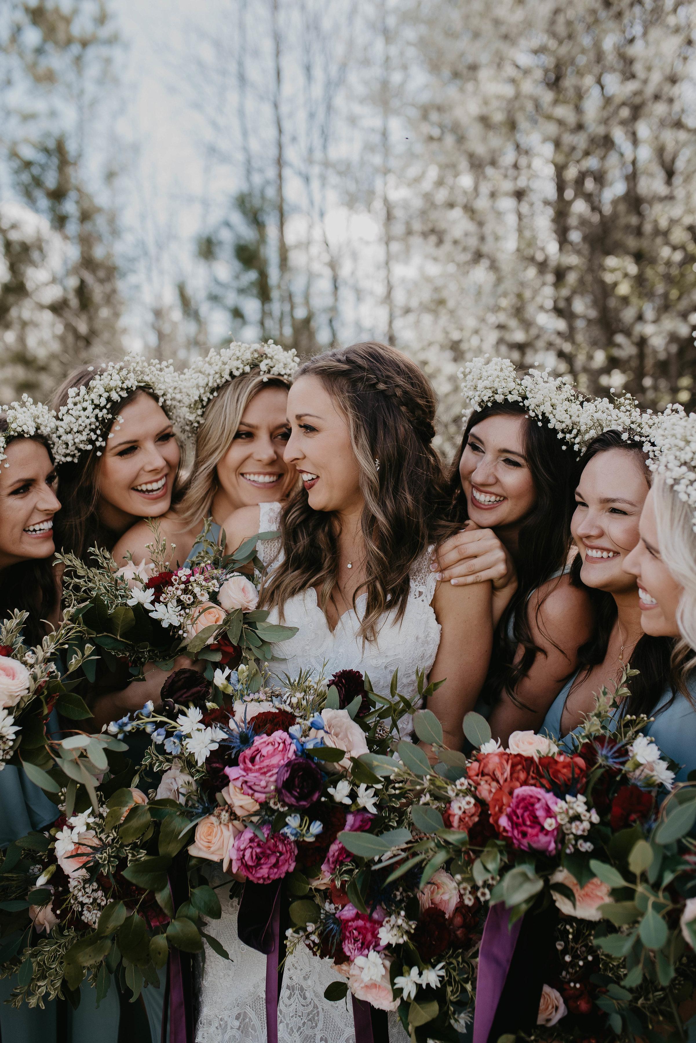 cuddles w bridesmaids.jpg