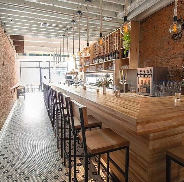 The competed build for @ripplewinebar is complete. The project included maple butcher block bar top and front, back bar and wine rack, 18 chairs, 16 bar stools, 16 backless stools, drink rail, butcher block tables, and live edge mamansia table. Photos by @ripplewinebar
