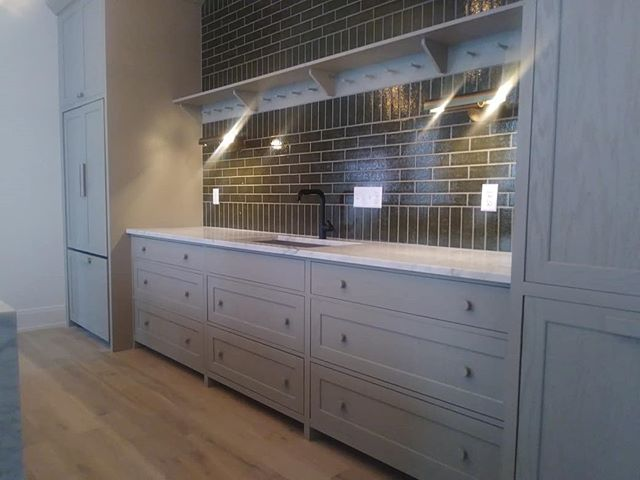 Painted oak kitchen cabinets, Shaker peg-rail, and island in the Bradford Building.