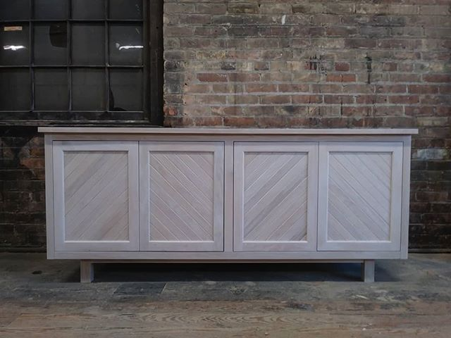 Whitewashed oak cabinet.