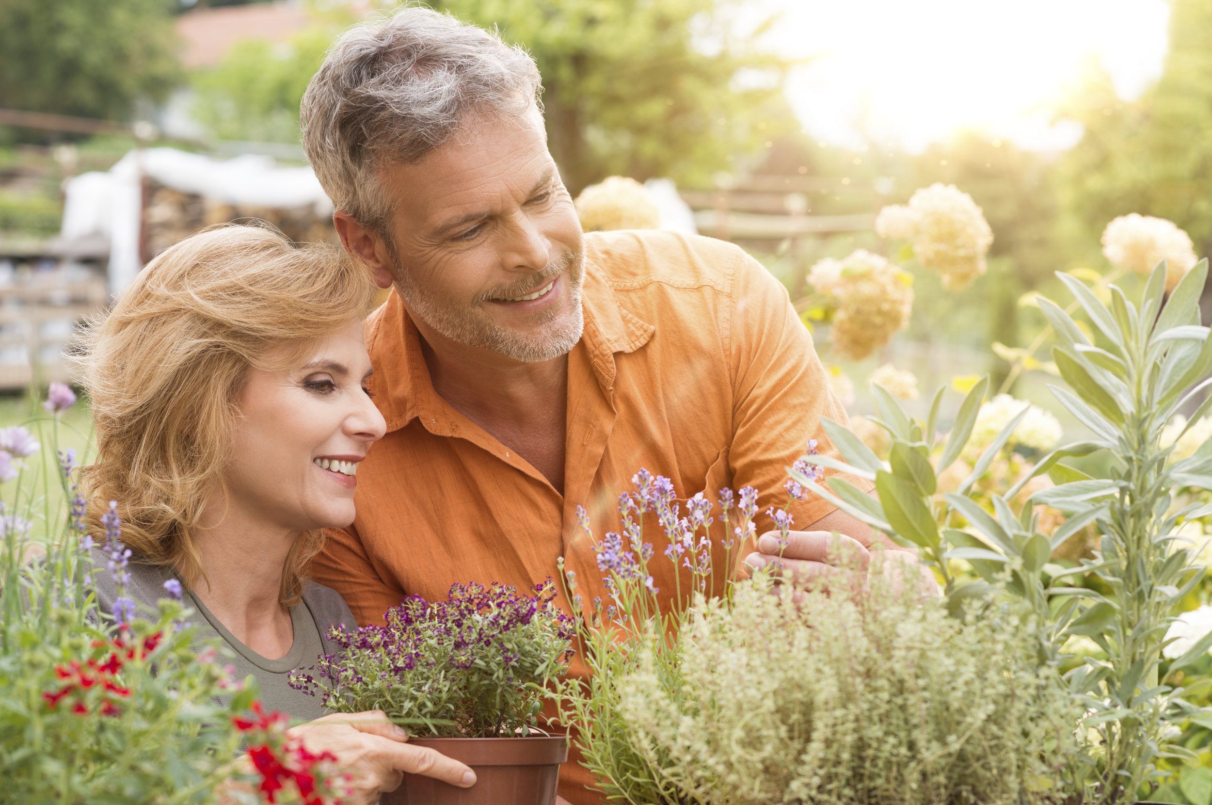 Older couple tending garden - Dental Implants Federal Way