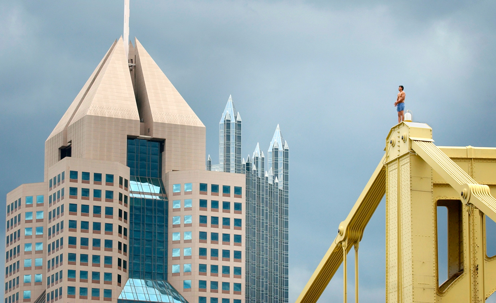 A man stands atop Pittsburgh's Roberto Clemente Bridge during rush hour. Police talked him down safely.