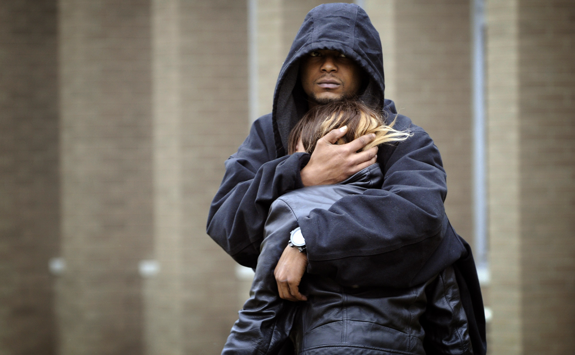 Young man comforts a friend at scene of a murder in Pittsburgh.