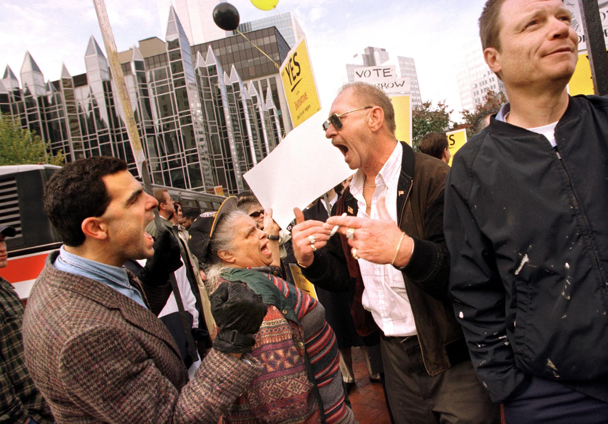 Voters argue in Market Square.