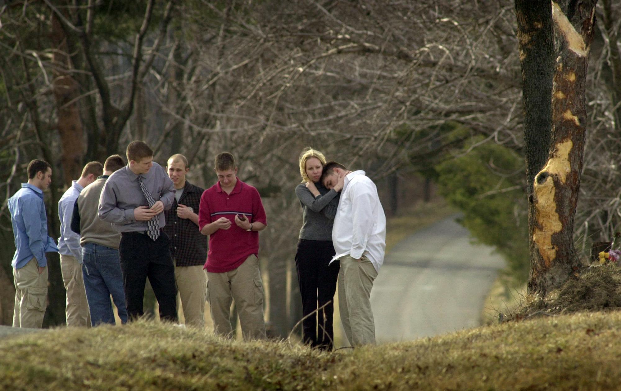 Slippery Rock High School students visit site of crash that killed three classmates.