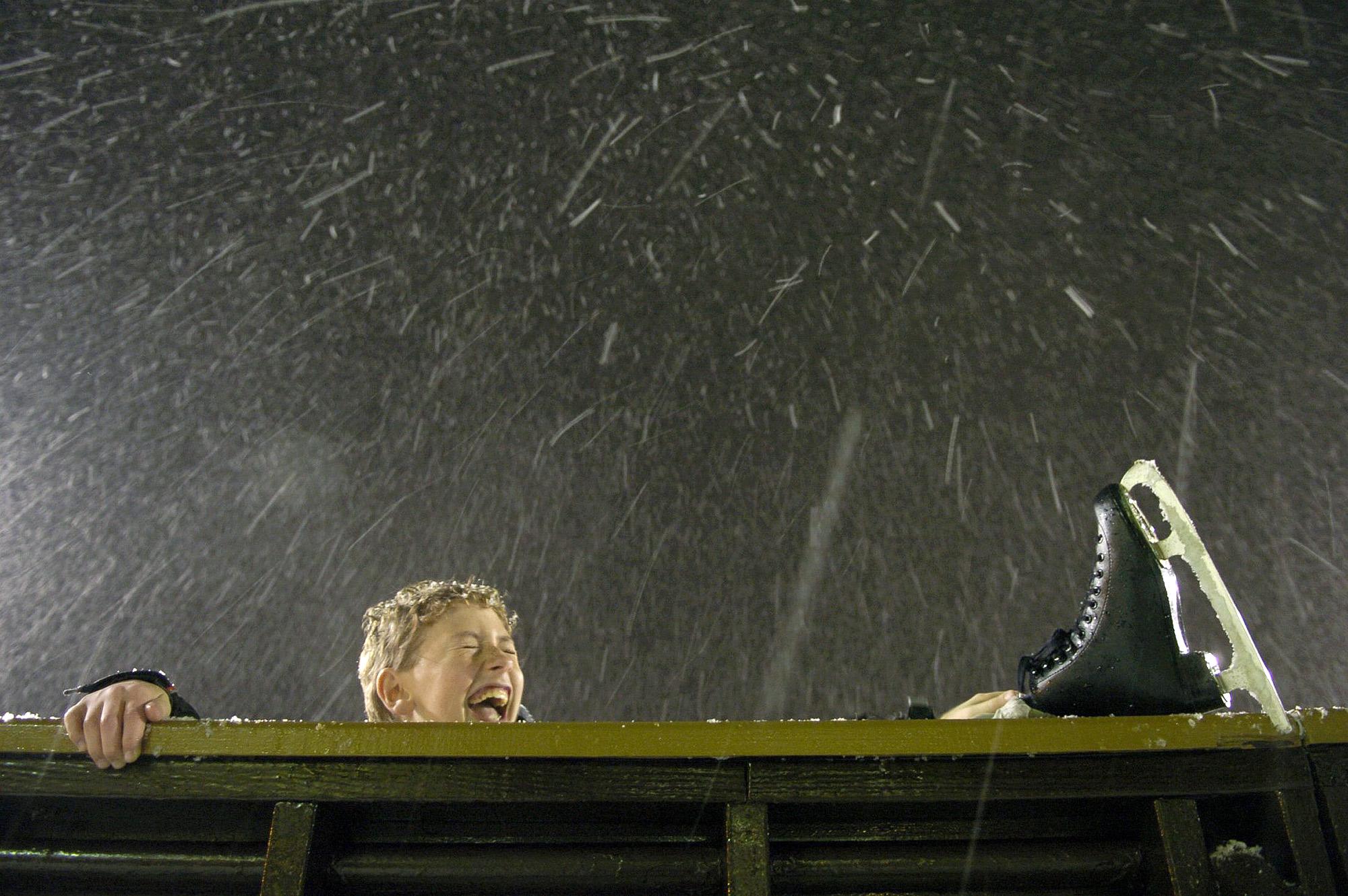 Joe Eisner has fun in a snowstorm at a Pittsburgh skating rink.