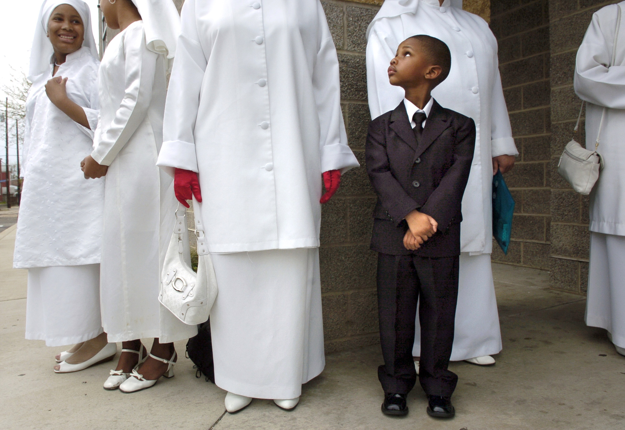 Hakeem Muhammad stands among women during a unity walk.