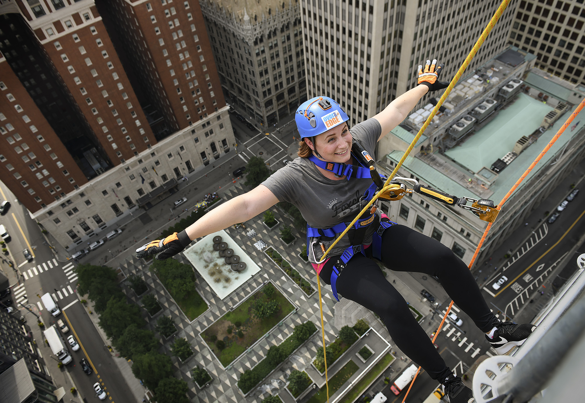 Morgan Glancy rappels down the 26-story Oliver Building in Pittsburgh.