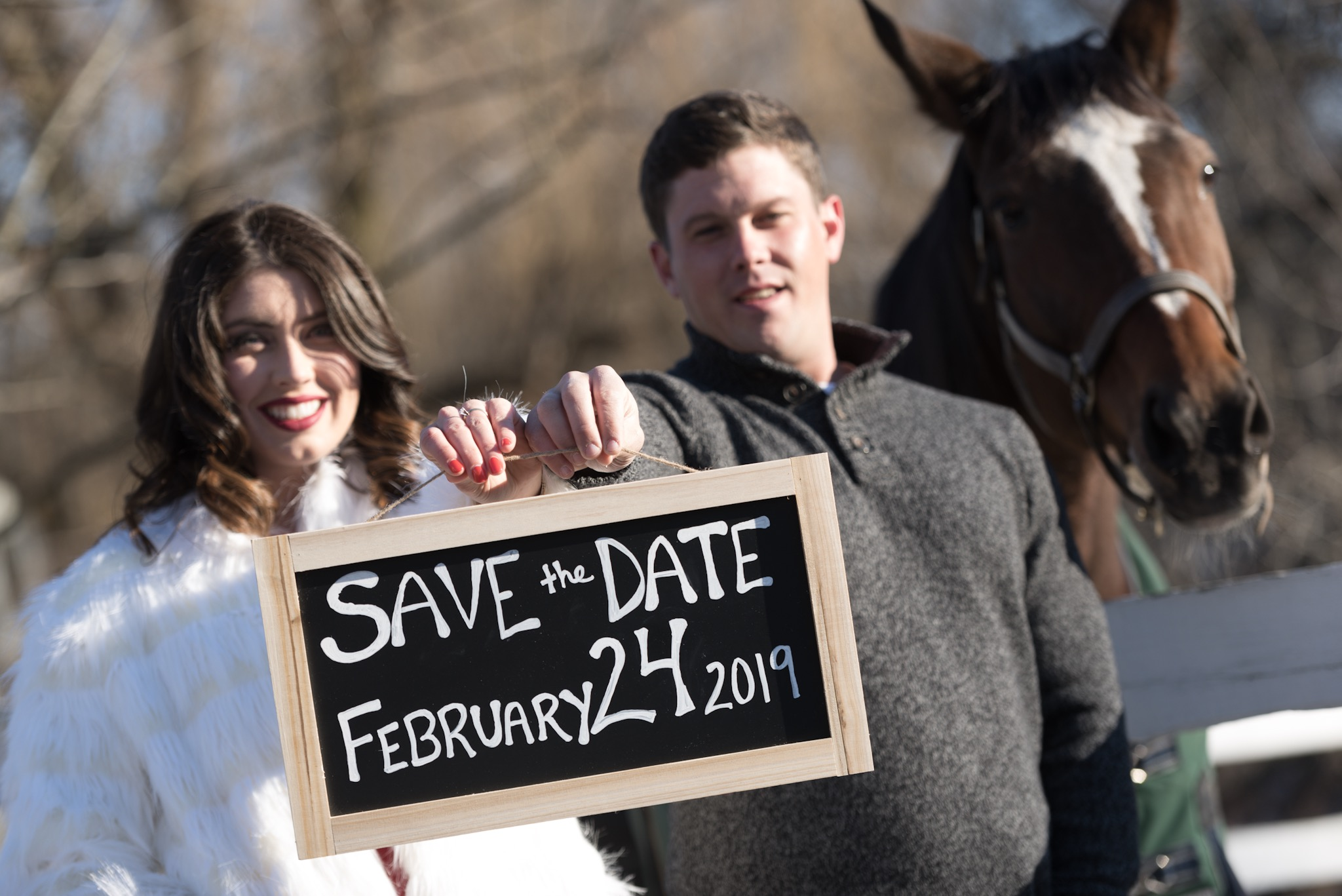 Save the date sign and Suzie the horse. Engagement Photographer Jason Giordano