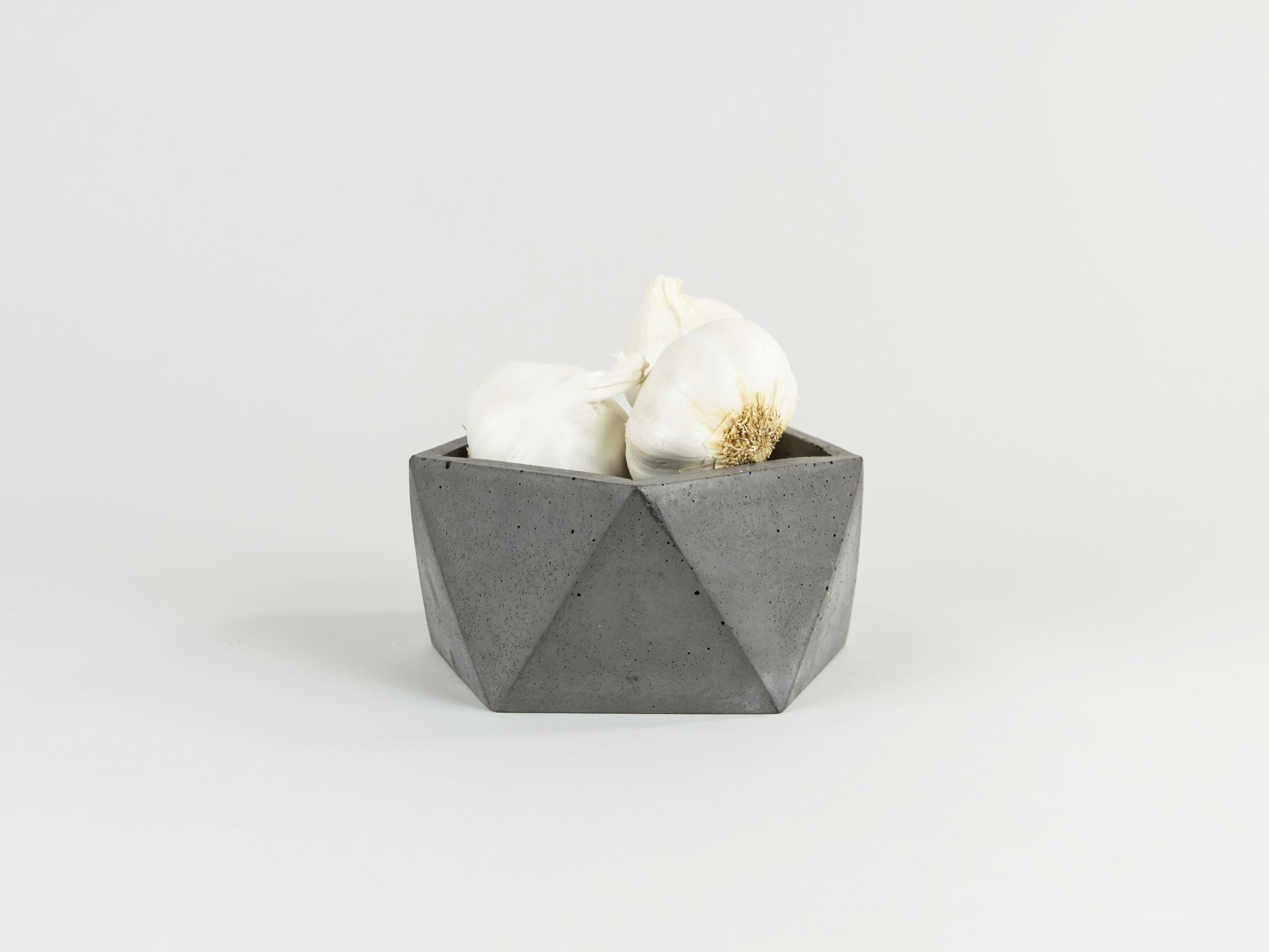 Copy of Modern Geometric shaped concrete dish with garlic by The savvy Heart