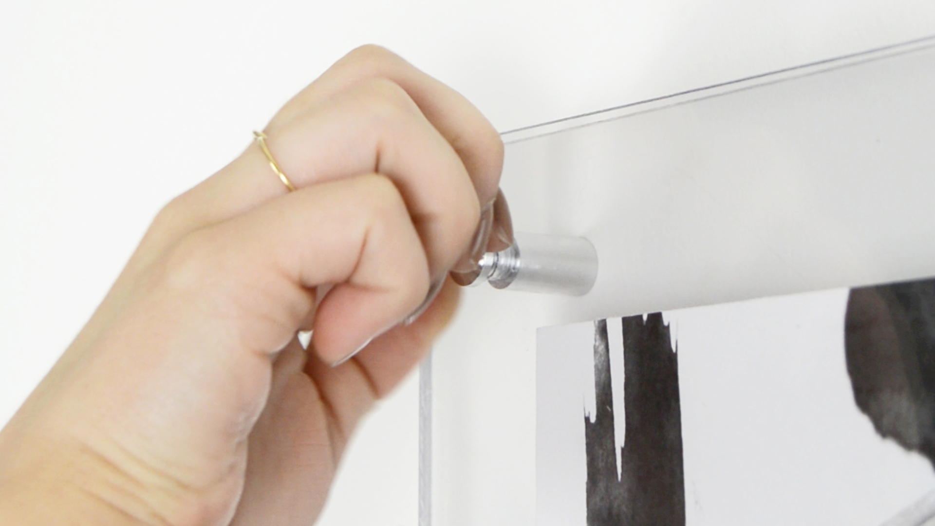 Silver metal standoffs used for hardware for floating acrylic Frame by The savvy Heart