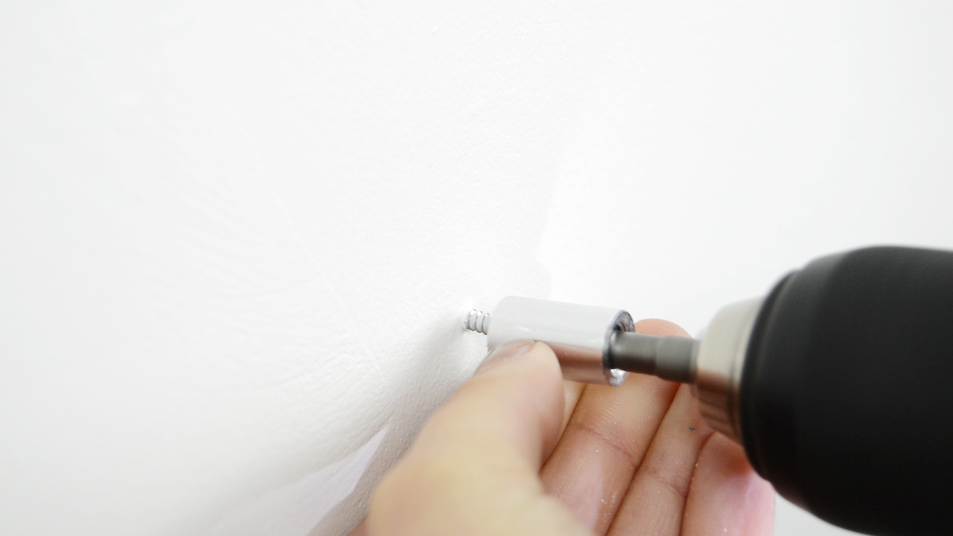 Drilling Metal Standoff backs into the Wall to support an Acrylic Frame
