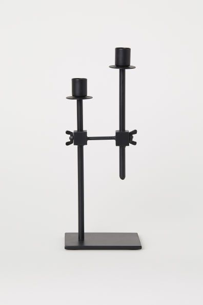 Black metal dual candlestick holder for a contemporary great room.jpg