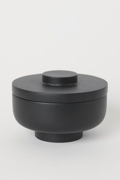 Modern and contemporary small lidded black container.jpg