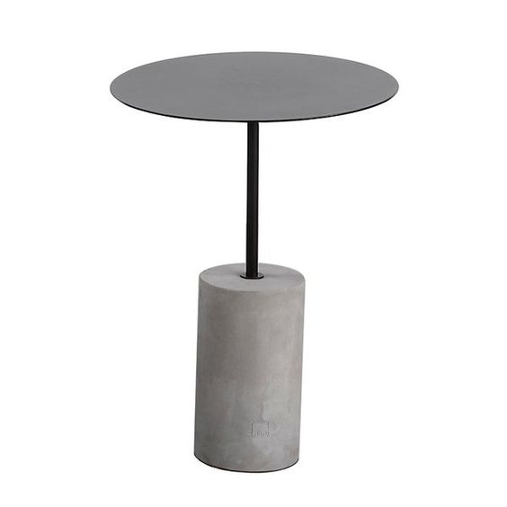 Small concrete and black circular side table for a contemporary living room.jpg