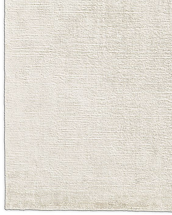 Simple and modern cream white area rug with subtile detail.jpg