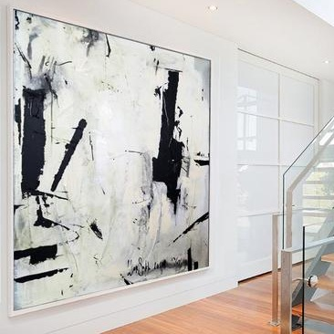 Large oversized abstract canvas wall art for a contemporary living room design.jpg