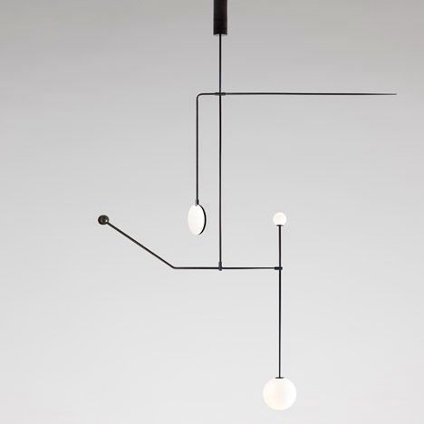 Minimal and sculptural black metal geometric chandelier.jpg