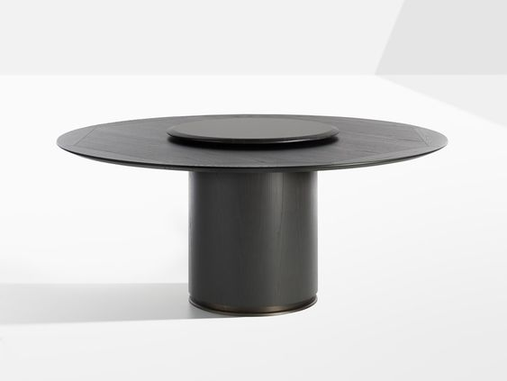 Black ROund Wood dining Table for a contemporary dining room.jpg