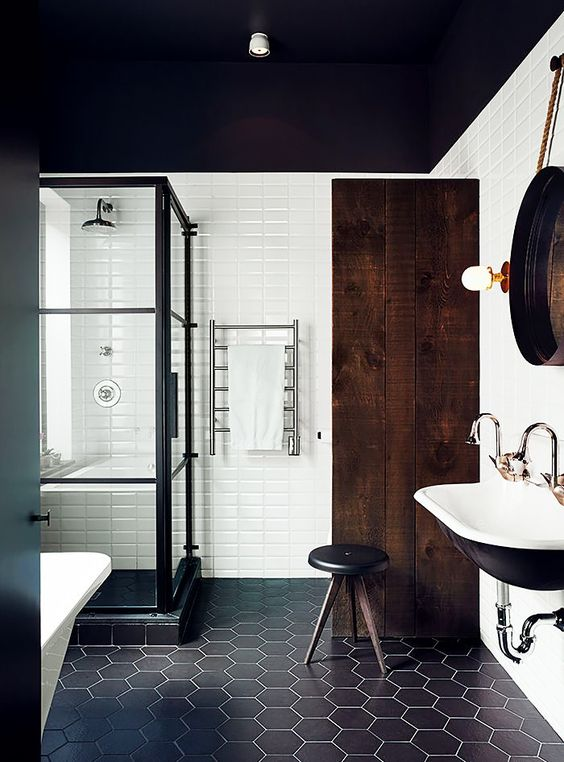 Mascule and feminine bathroom with hexagon black tile and wood accents.jpg