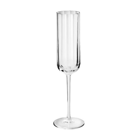 Champagne flute with fluted glass that has a ribbed texture - chic interior design and decor trends by the savvy heart.jpg