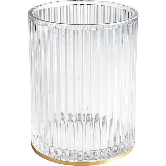Ribbed glass waste basket with a gold base - interior design and decor trends of 2019 and 2020 by the savvy heart.jpg