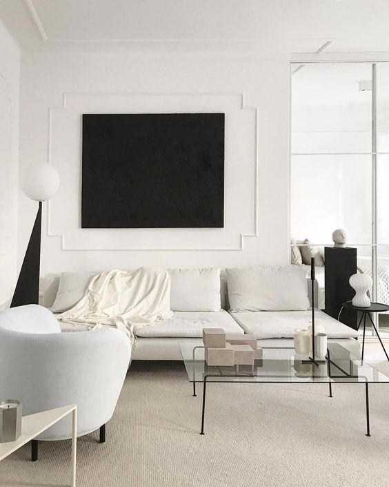 Simple white on white room with a cream and ivory area rug - see our favorite picks with best reviews.jpg