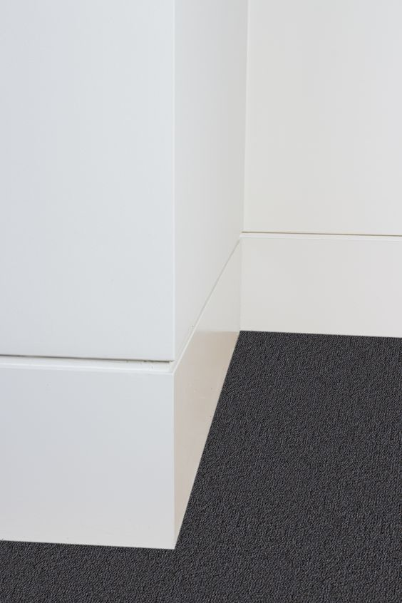Modern and minimal shadow reveal flush mount molding and trim for baseboards.jpg