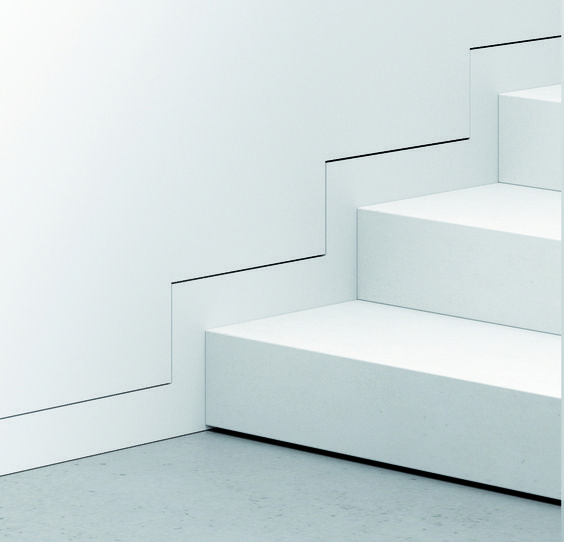 Minimalist Modern Flush Shadow Reveal Baseboards up white staircase.jpg