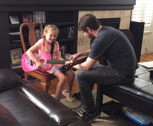 Tony with Guitar Student
