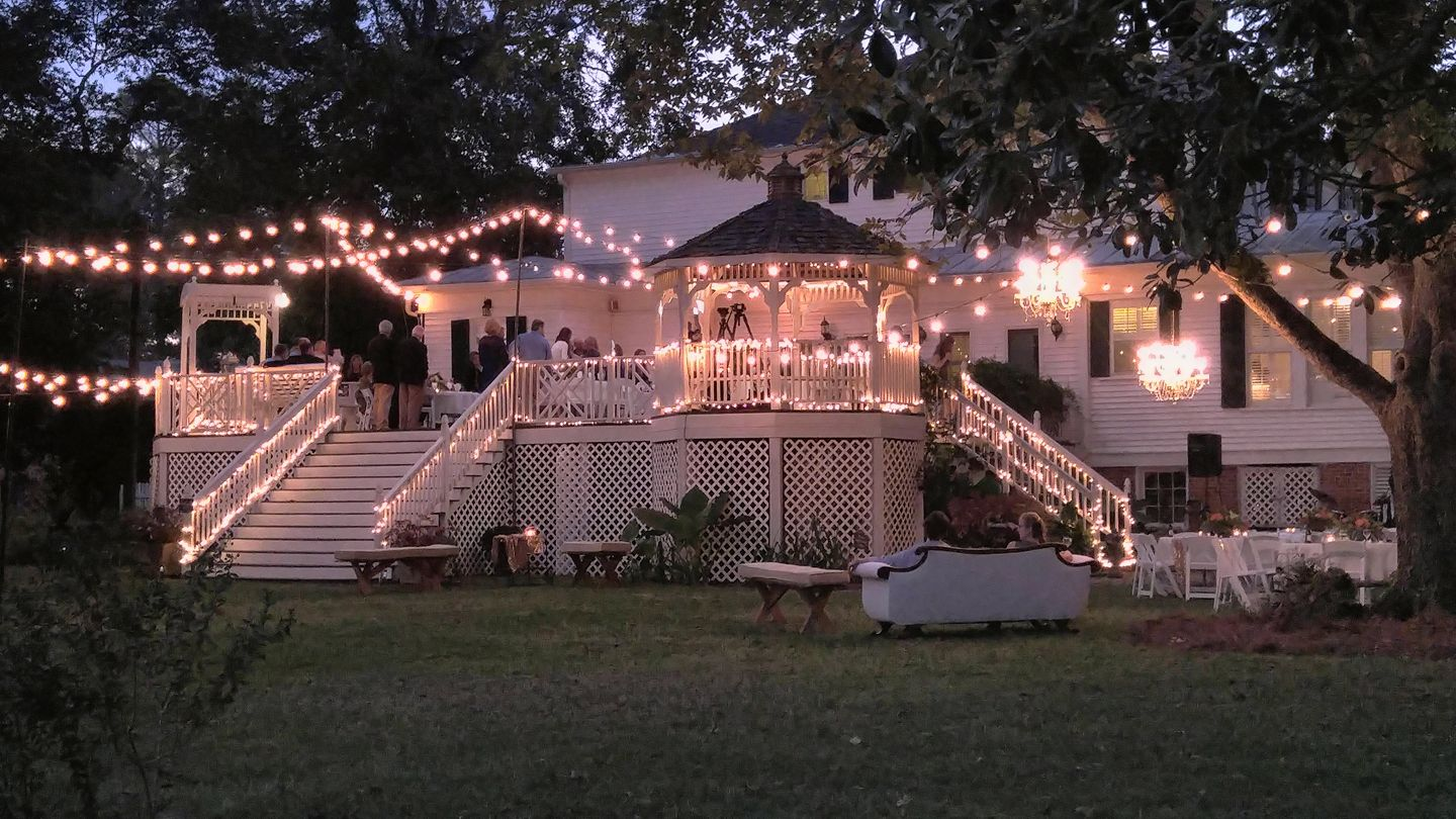 backyard up in lights at the grand magnolia house.jpg